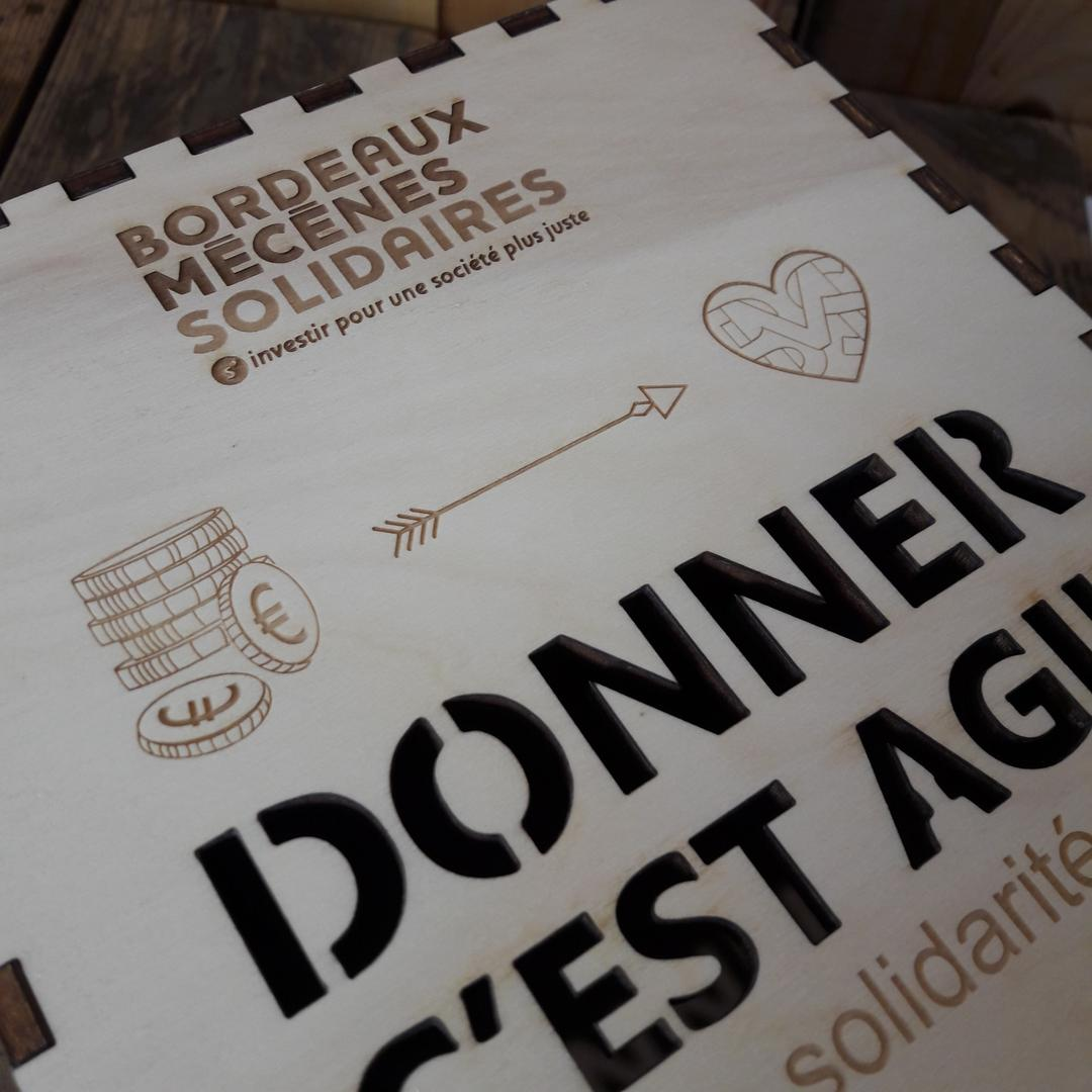 Urne de dons en bois gravé et découpé par laser pour Bordeaux Mécènes solidaires