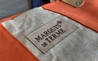 Produits «dérivés» pour le Château Marquis de Terme : porte-clés, étiquettes de sac à main et marque-pages en cuir