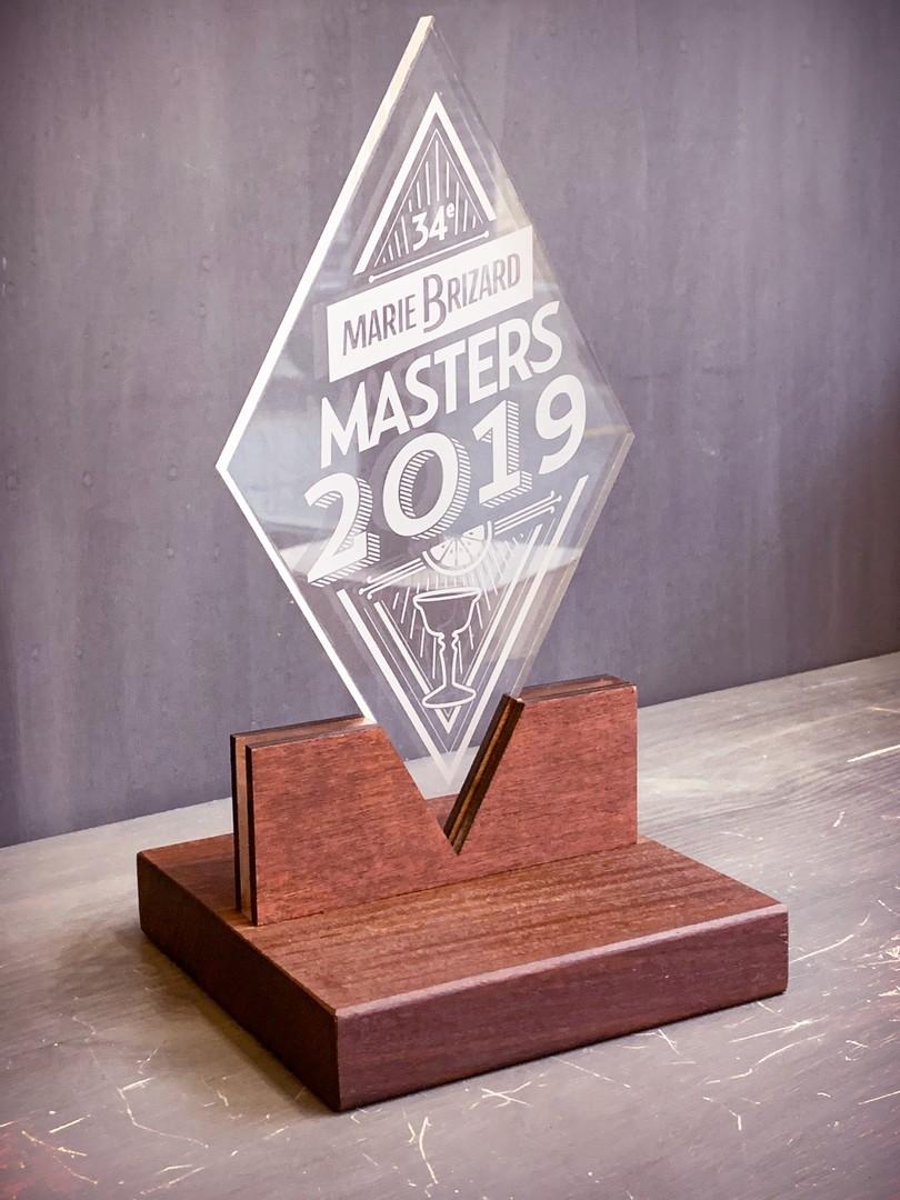 Trophées pour la compétition internationale de cocktail Masters Marie Brizard en bois et acrylique par gravure et découpe laser