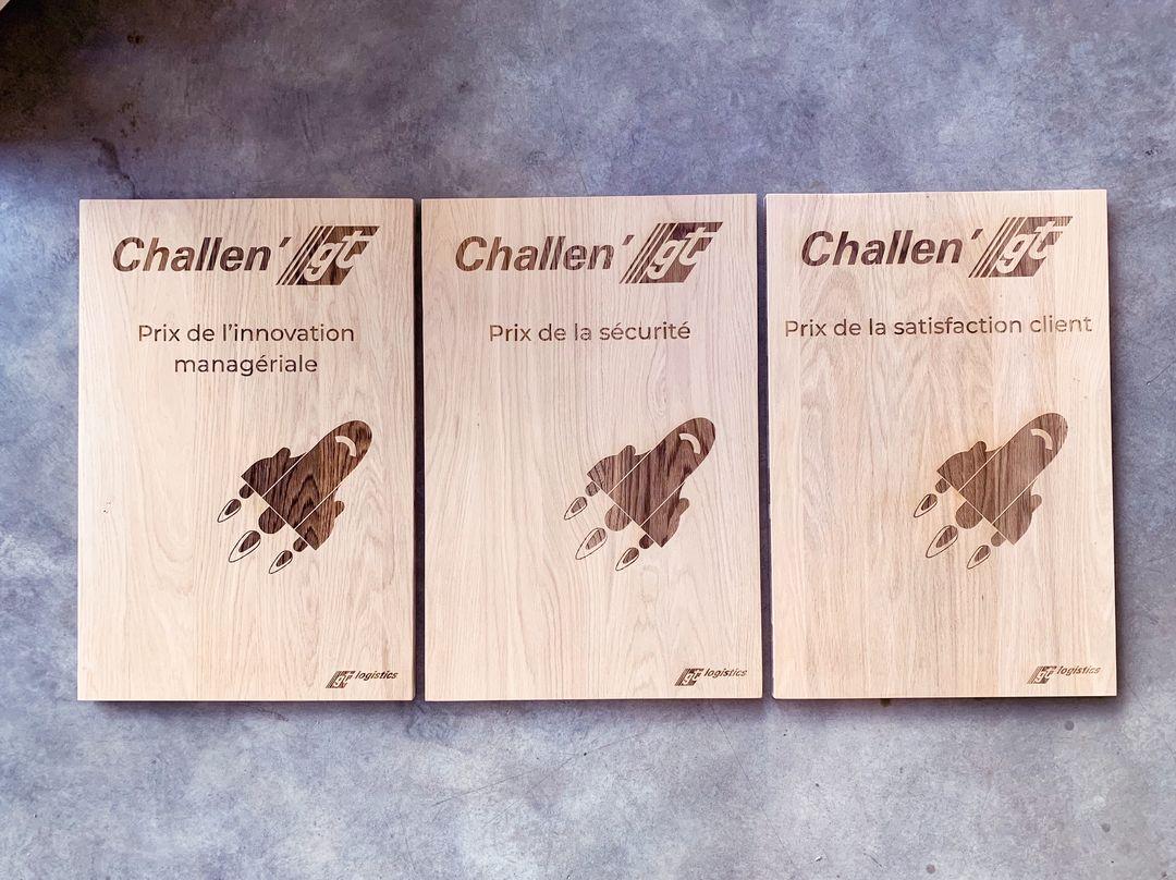 Trophées récompenses prix sur bois chêne gravure et decoupe laser pour GT logistics