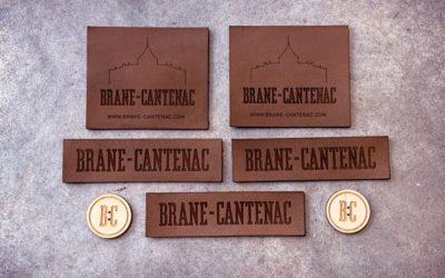 Étiquettes cuir et bouton en bois pour le château Brane-Cantenac